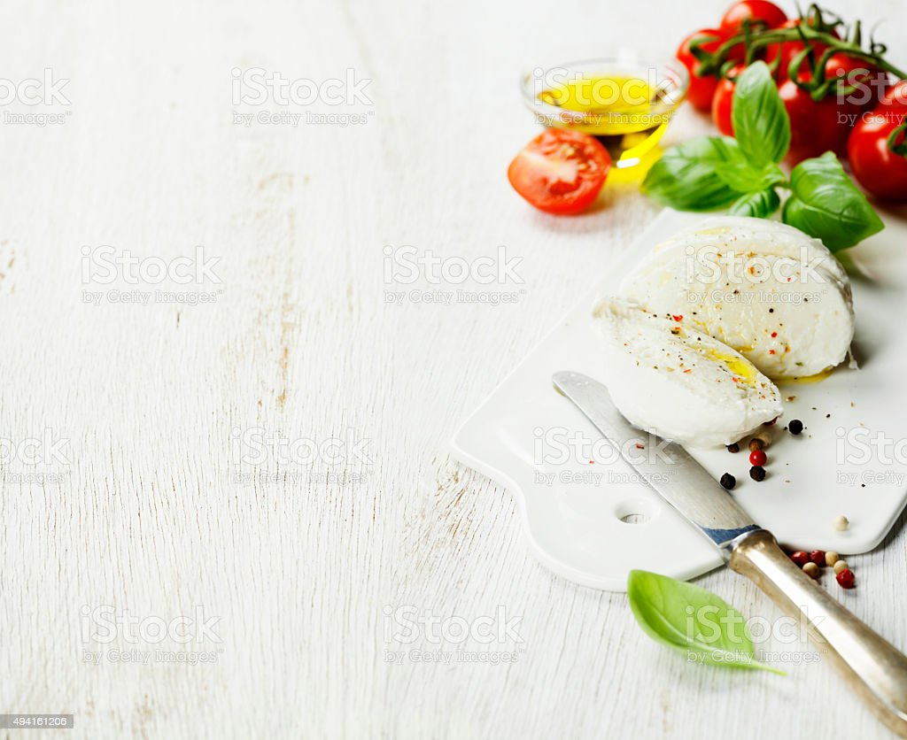 mozzarella, organic cherry tomatoes and fresh basil stock photo