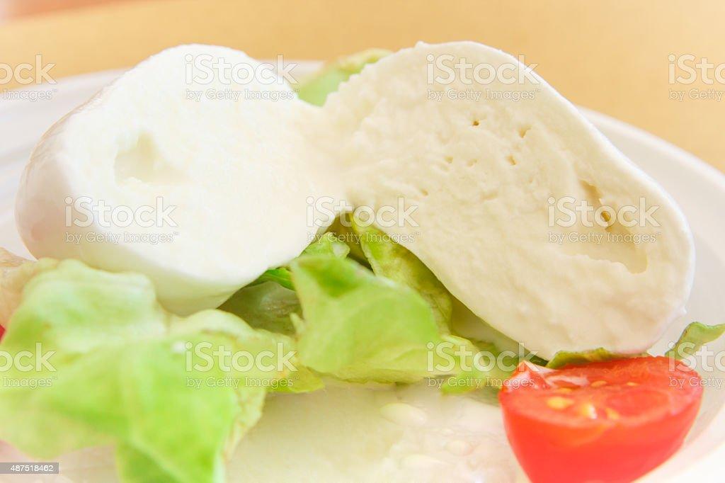 mozzarella, organic cherry tomatoes and fresh lettuce stock photo