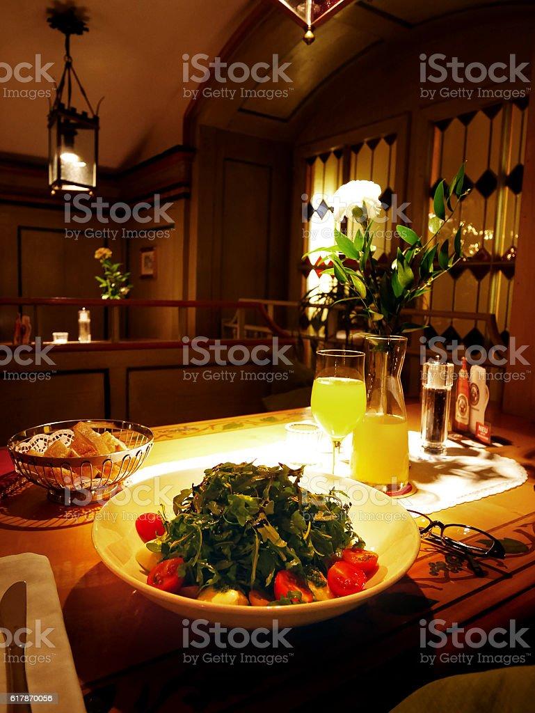 Mozzarella salad at a dimly lit dinner stock photo