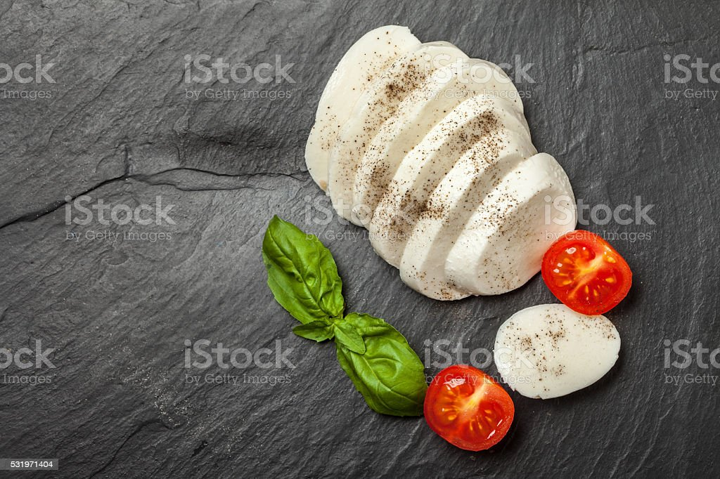 Mozzarella, tomato and basil. stock photo