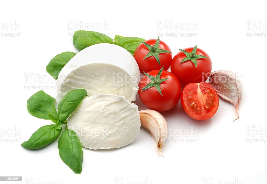 Mozzarella, tomatoes, basil and garlic stock photo