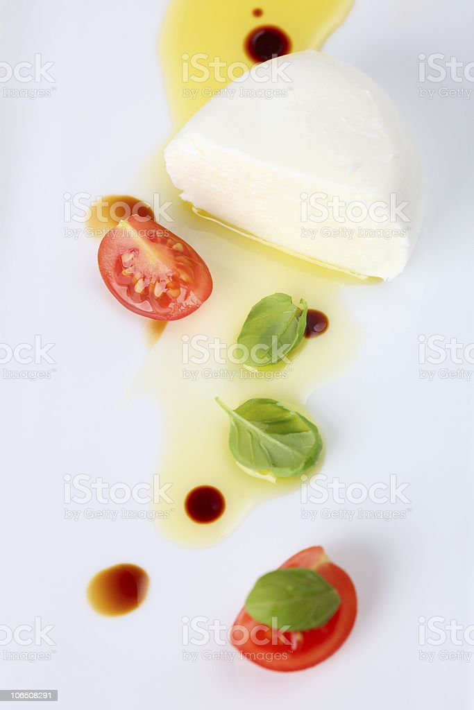 Mozzarella Tomatoes with Basil Oil Balsamico Top View royalty-free stock photo