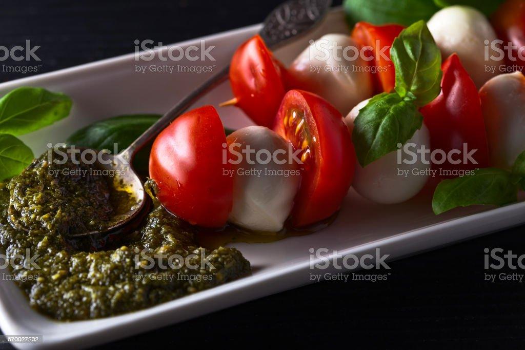 Mozzarella with tomato , basil  and pesto sauce royalty-free stock photo