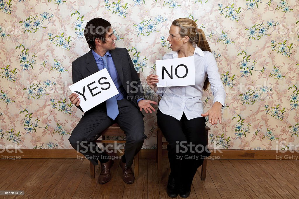 Mr Yes and Miss No fighting royalty-free stock photo