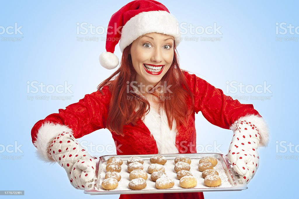 Mrs. Claus baking Christmas cookies royalty-free stock photo