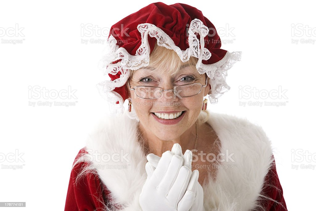 Mrs. Claus Claps Her Hands Together stock photo