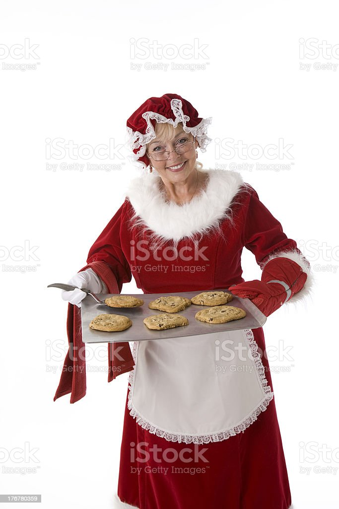 Mrs. Claus Offers a Fresh Baked Chocolate Chip Cookie royalty-free stock photo