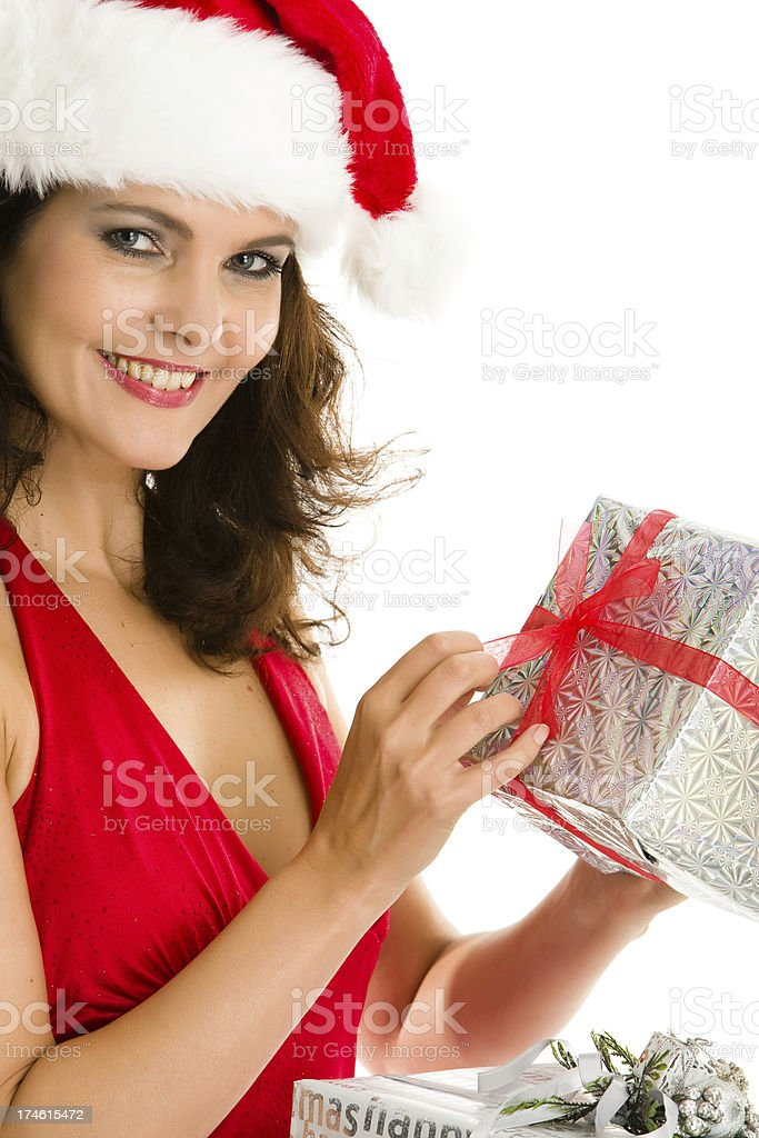 Mrs. Claus opening a present royalty-free stock photo