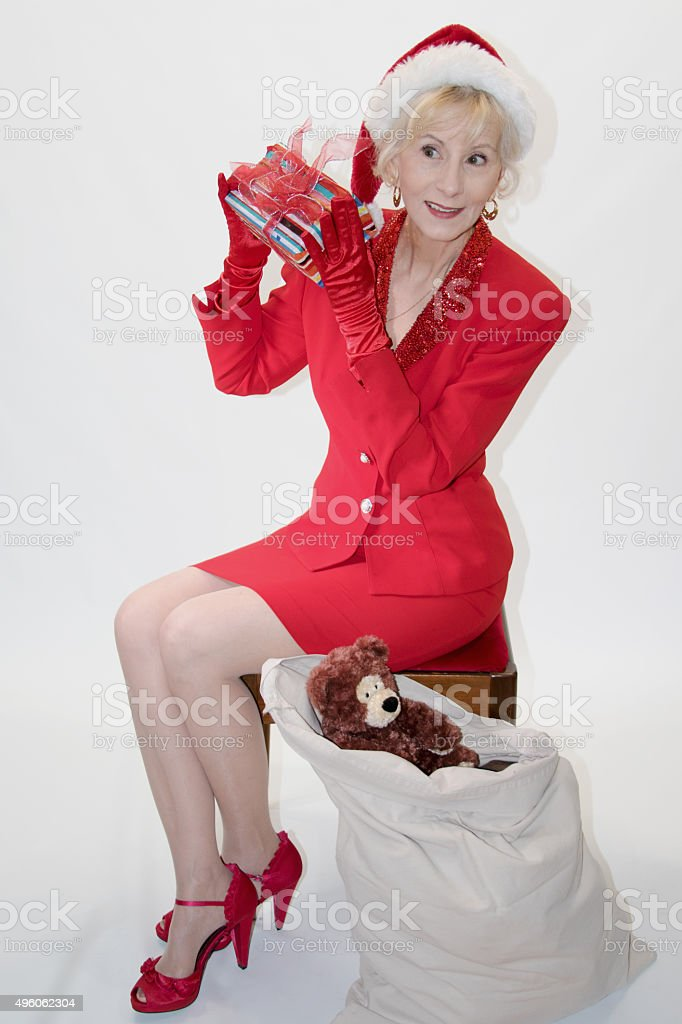 Mrs Claus Shaking A Present stock photo