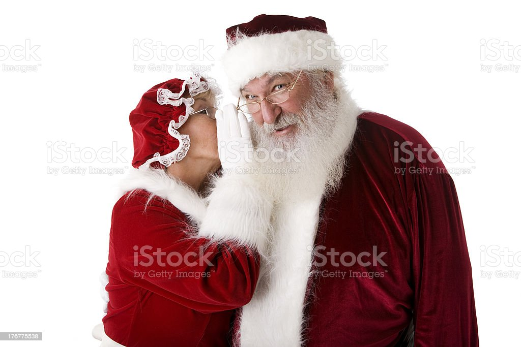 Mrs. Claus Whispers a Secret to Santa stock photo
