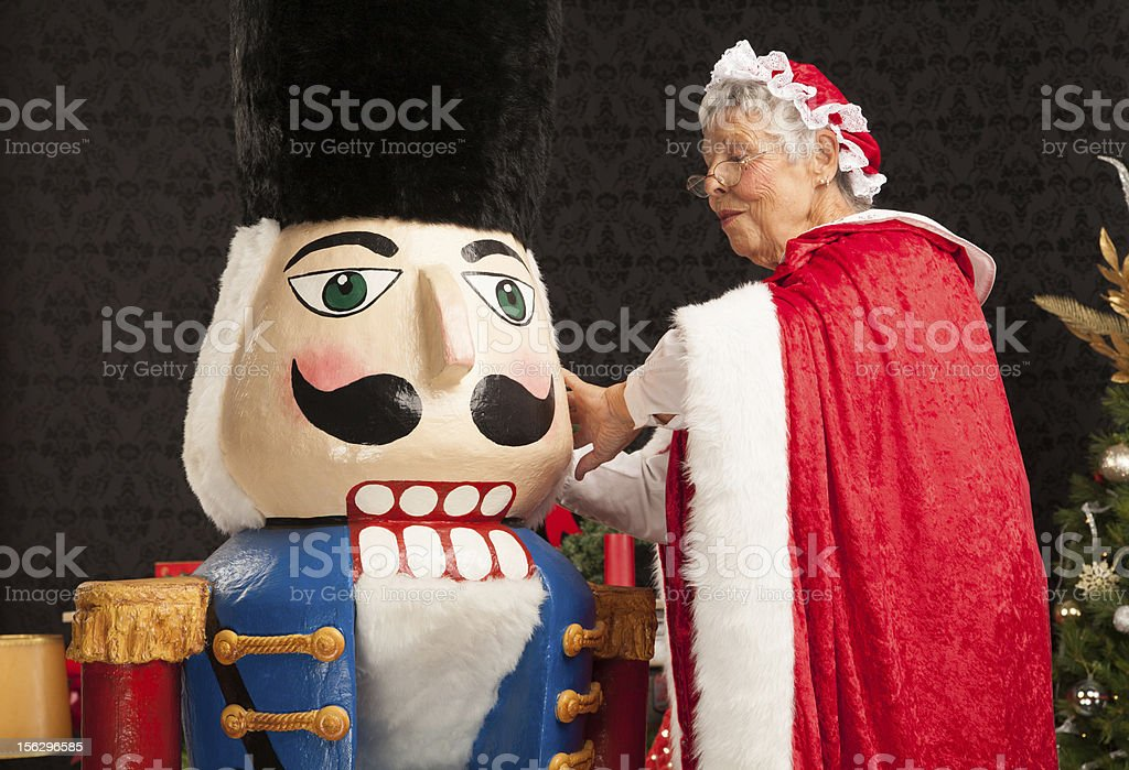 Mrs. Clause finishes building the giant nut cracker royalty-free stock photo
