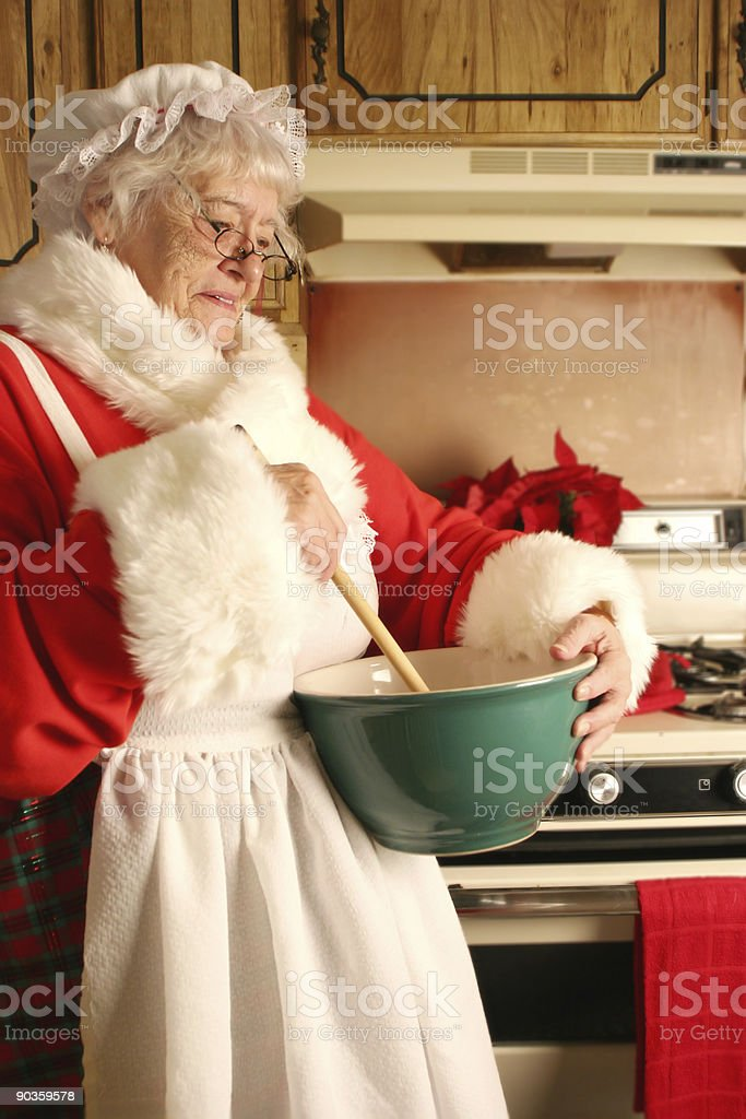 Mrs Clause in the kitchen stock photo