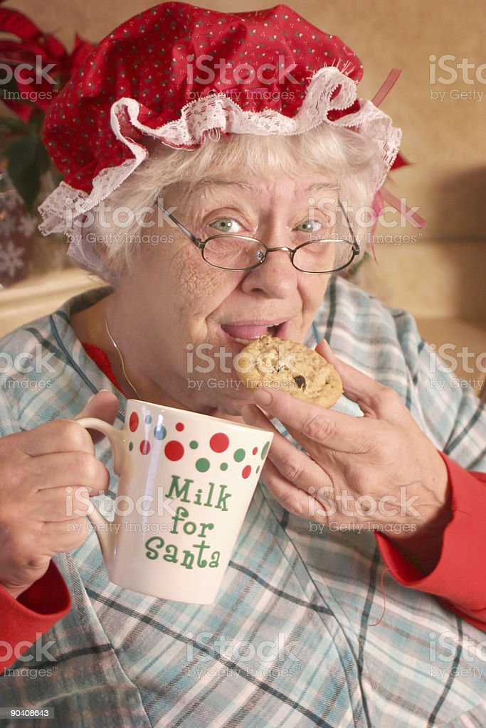 Mrs Clause sneaking cookies stock photo