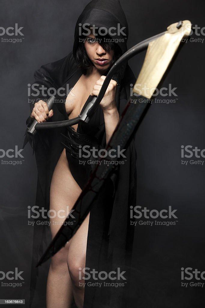 Mrs. Death holding a scythe stock photo