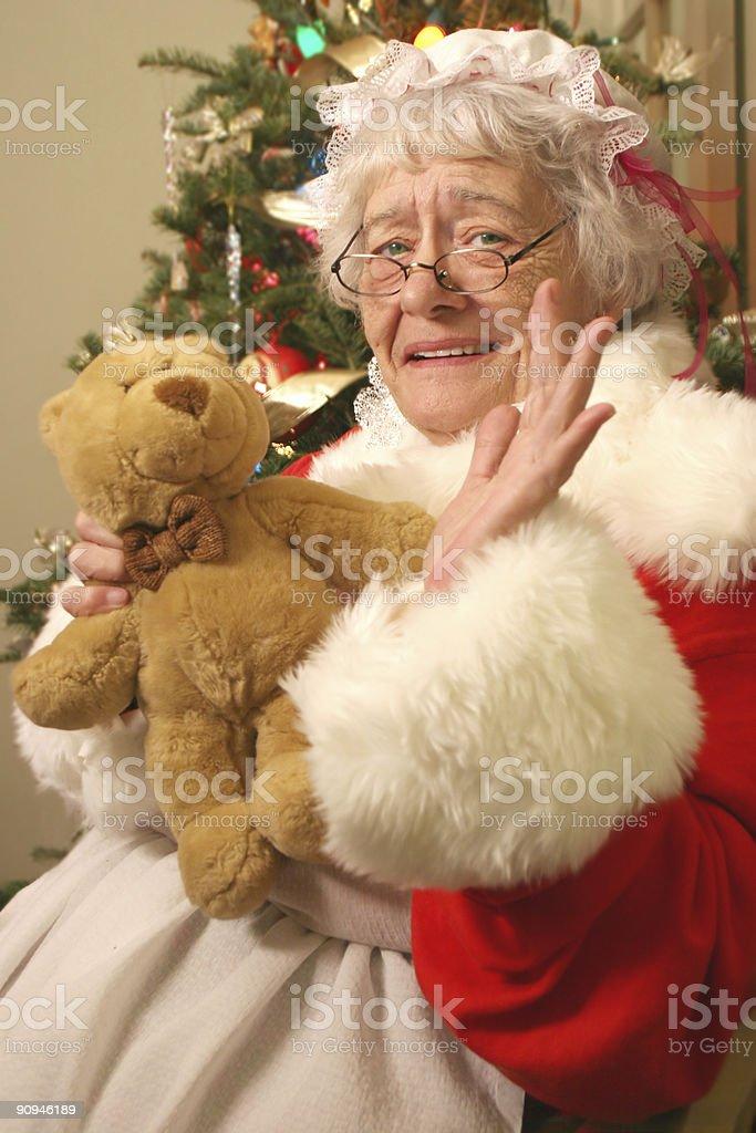 Mrs Santa and Teddy Waves Hello stock photo