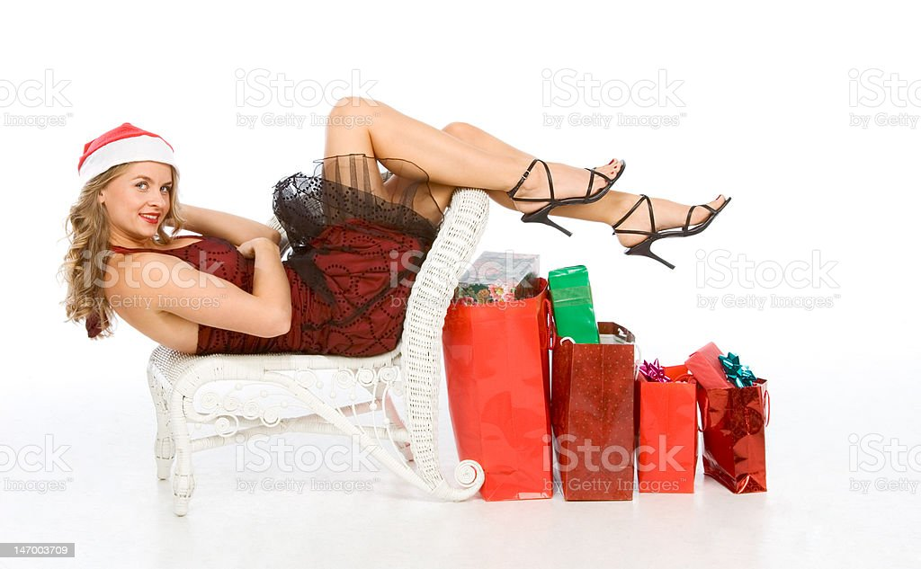 Mrs Santa Claus with lot of Christmas presents royalty-free stock photo
