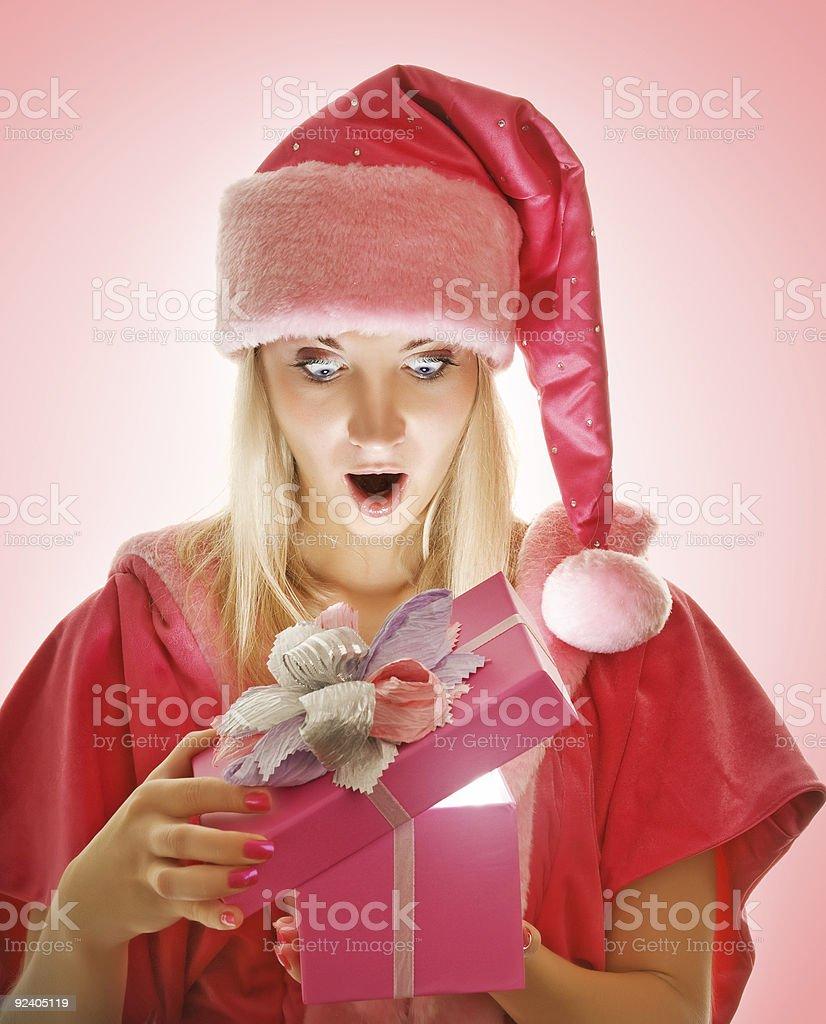 mrs. Santa opening a gift box royalty-free stock photo