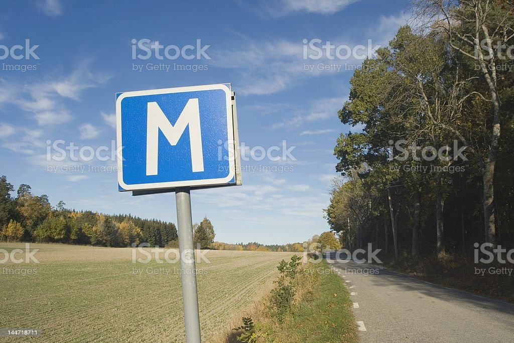 M-sign on narrow country road royalty-free stock photo