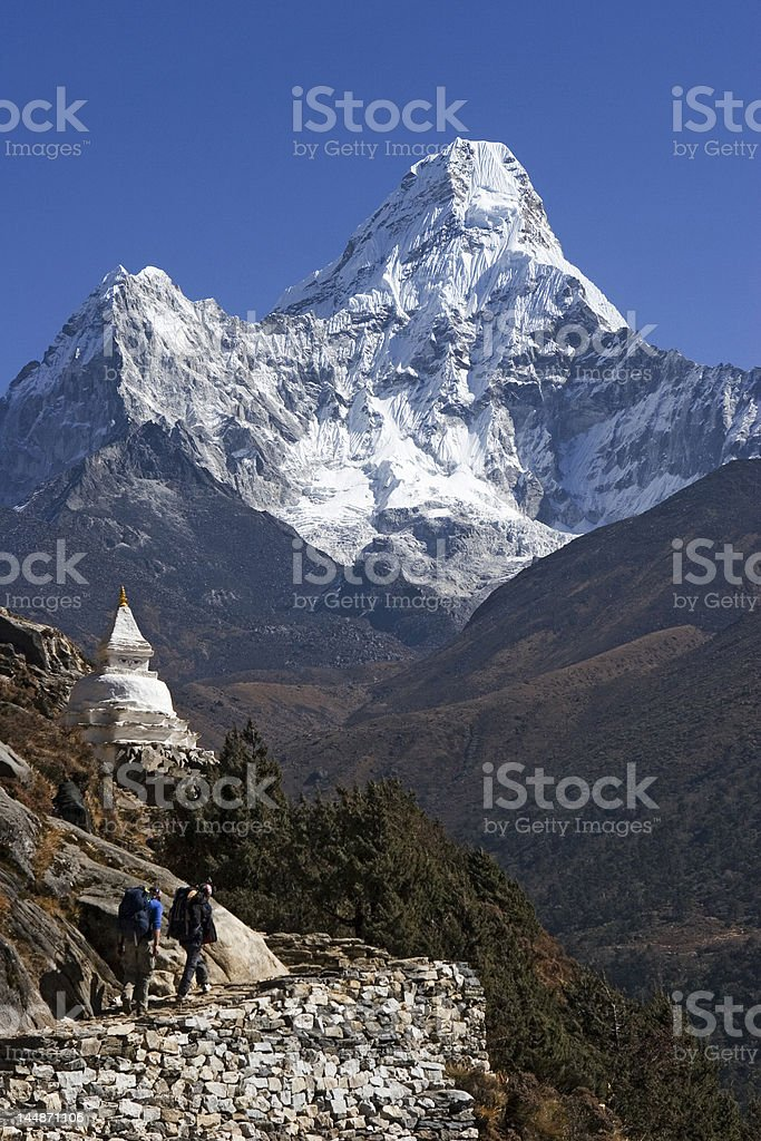 Mt. Ama Dablam and trekkers royalty-free stock photo