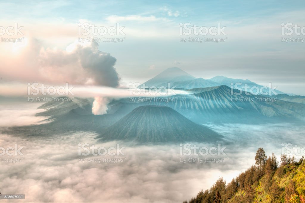 Mt. Bromo volcano during sunrise, the magnificent view of Mt. Bromo located in Bromo Tengger Semeru National Park, East Java, Indonesia. stock photo