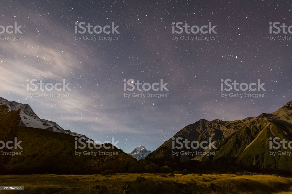 mt. cook at night with stars in the sky stock photo