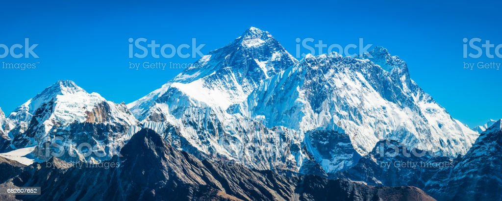 Mt Everest 8848m towering over Himalayan mountain peaks panorama Nepal stock photo