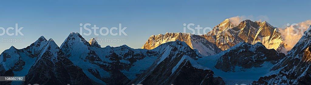 Mt Everest golden sunset panorama Lhotse Nuptse mountain peaks Himalayas royalty-free stock photo