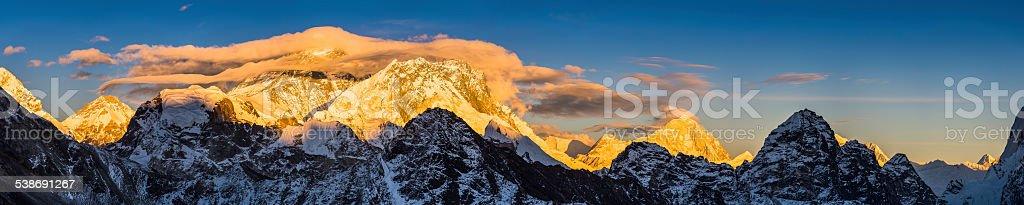 Mt Everest golden sunset panorama over Himalaya mountain peaks Nepal stock photo