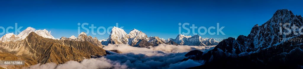 Mt Everest peaks panorama Himalayan mountain range above the clouds stock photo