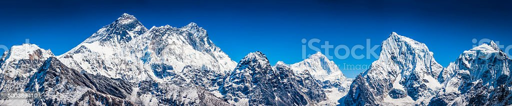 Mt Everest summit overlooking Himalayas snowy mountain peaks panorama Nepal stock photo