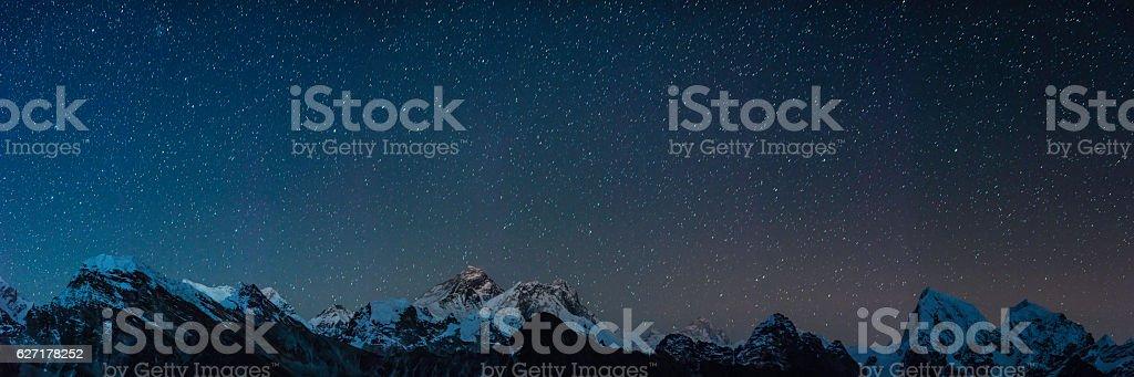 Mt Everest summit stars shining over Himalaya mountain peaks panorama stock photo