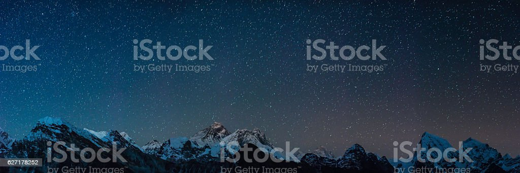Mt Everest summit stars shining over Himalaya mountain peaks panorama stock photo