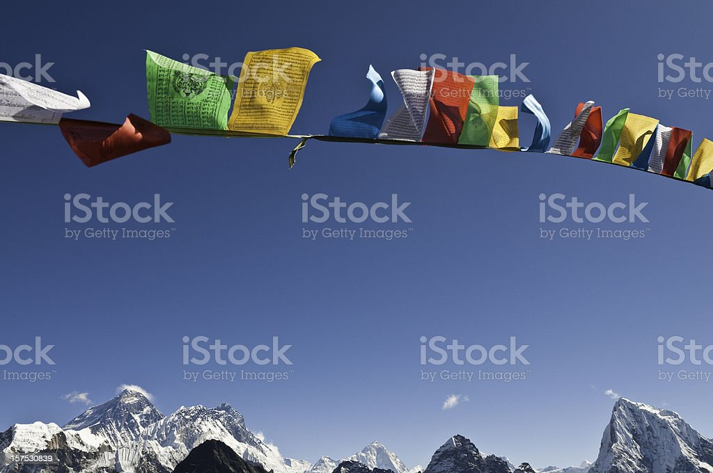Mt Everest summit vibrant buddhist prayer flags flying blue sky stock photo