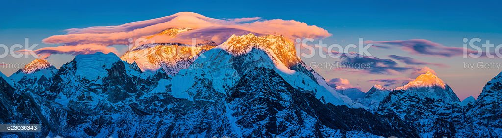 Mt Everest sunset panorama lenticular clouds over Himalaya mountain peaks stock photo