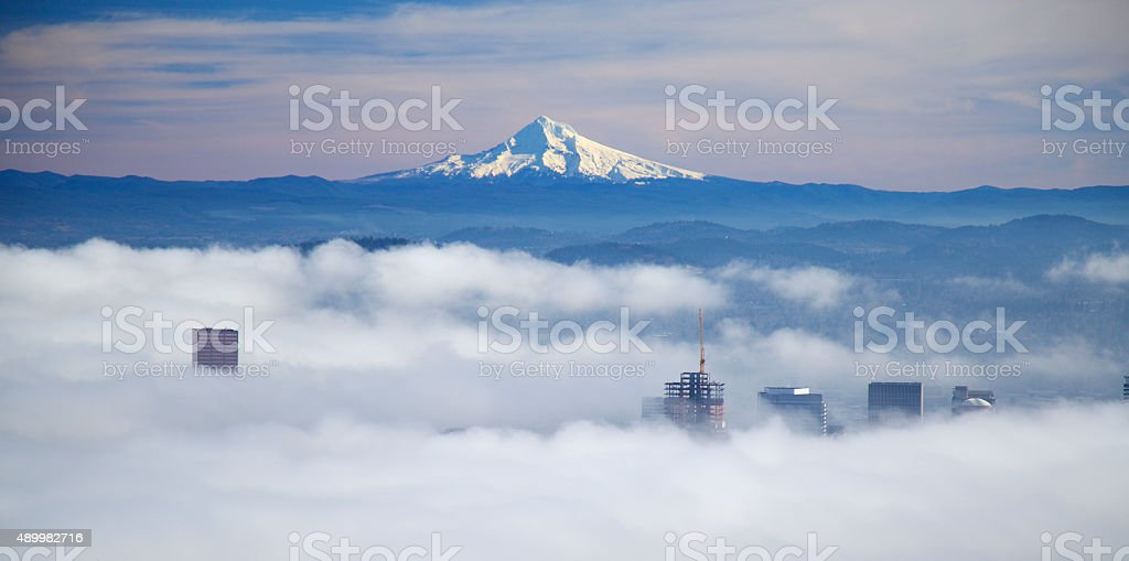 Mt Hood above the fog in Downtown Portland stock photo