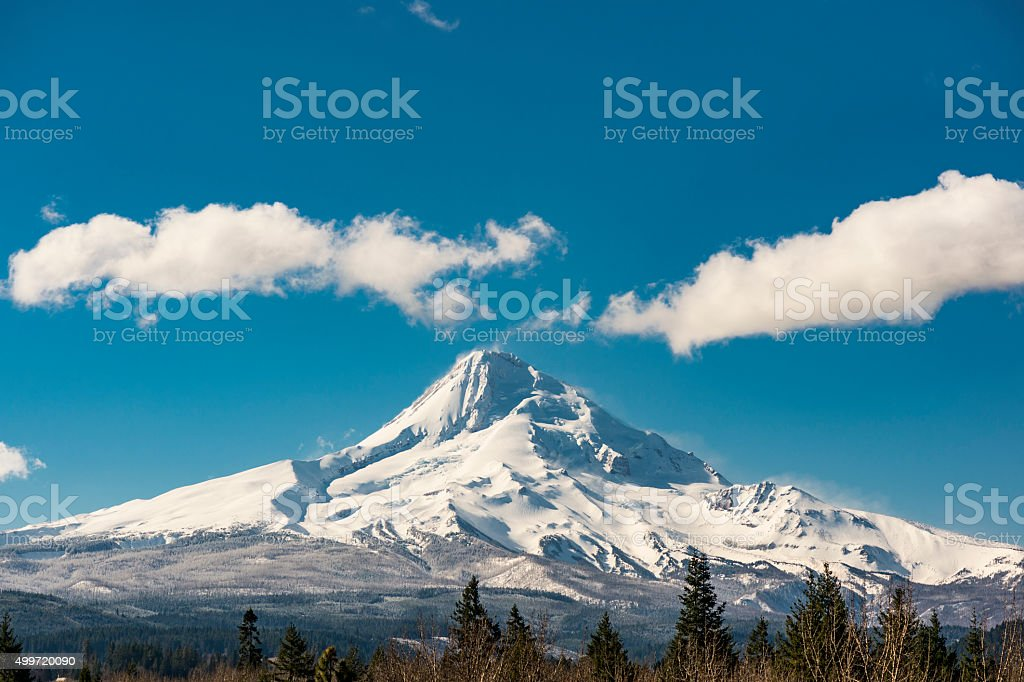 Mt Hood North Side Oregon with Snow Trees Clouds Sky stock photo