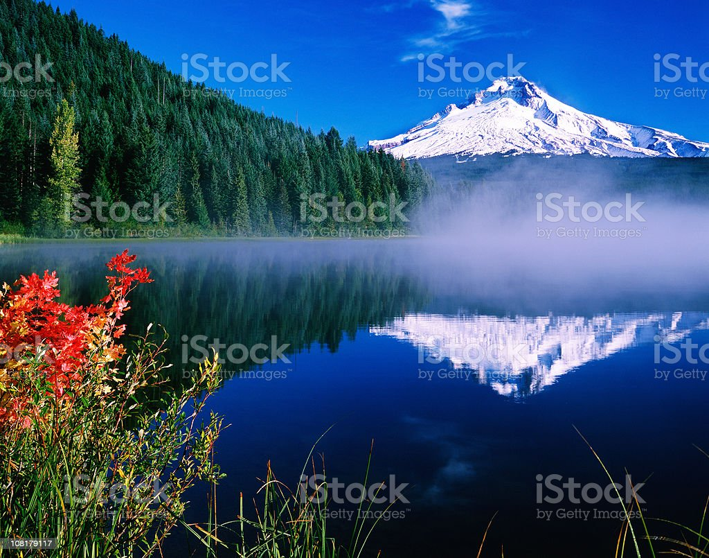 Mt Hood Reflected in Foggy Lake on Blue Sky Day stock photo