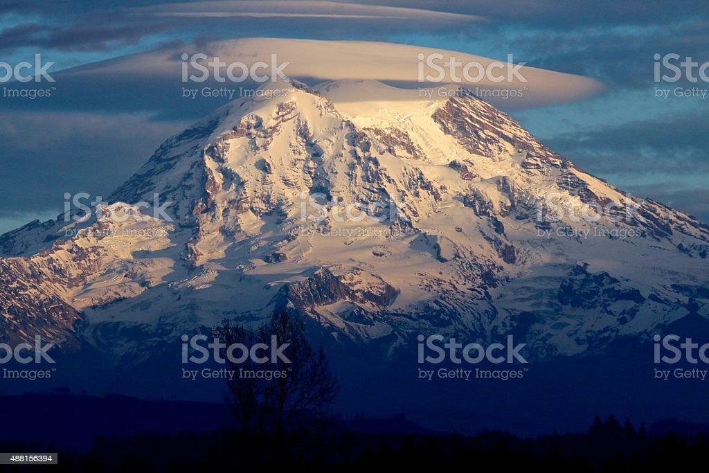 Mt. Rainier and the lenticular cloud stock photo