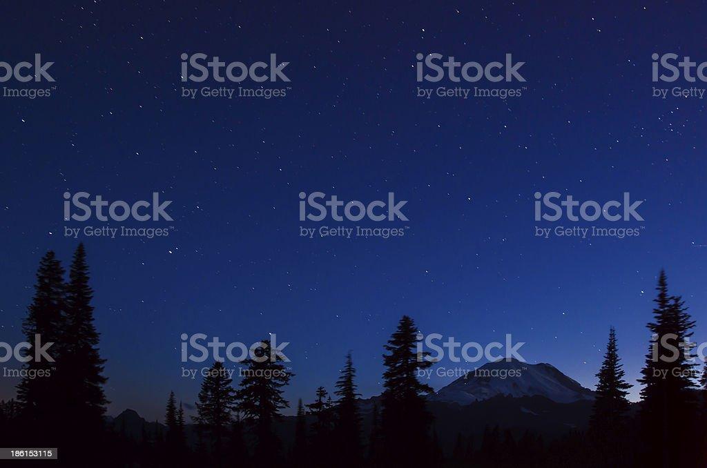Mt. Rainier at night from Upper Tipsoo Lake with stars stock photo