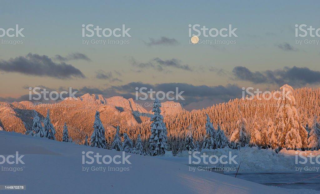 mt. seymour at sunrise with moonset in the west royalty-free stock photo