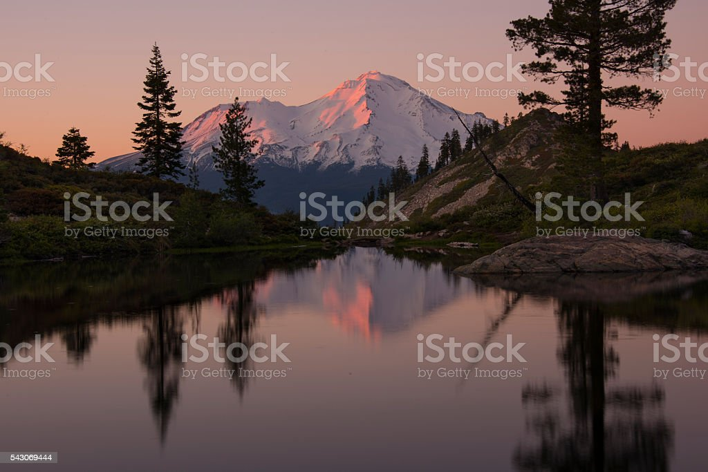 Mt. Shasta sunset reflection. stock photo