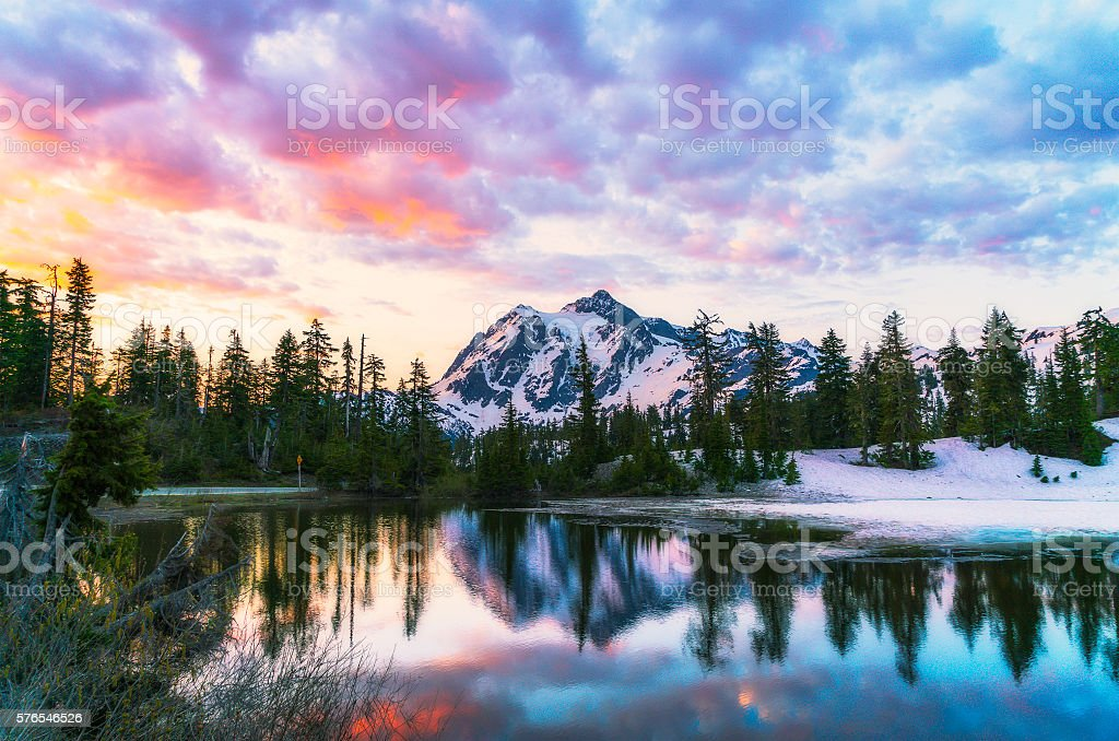 mt. Shucksan with reflection on the lake when sunrise. stock photo
