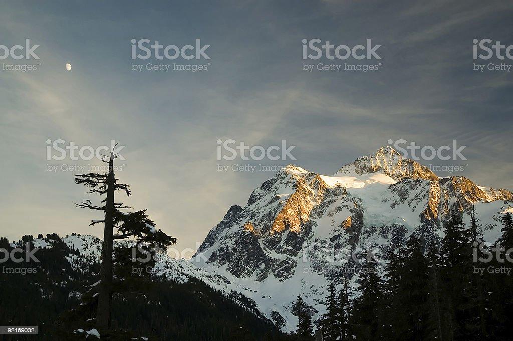 Mt Shuksan - Moon rising as sun sets royalty-free stock photo