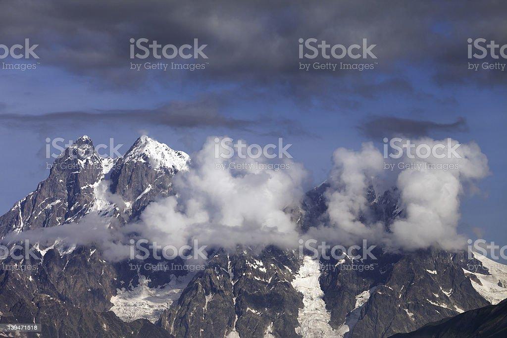 Mt. Ushba in clouds, Caucasus Mountains, Georgia, Svaneti. royalty-free stock photo