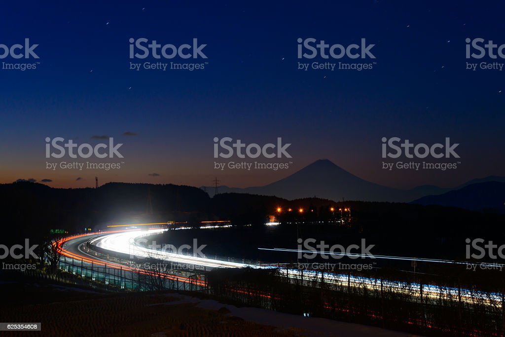 Mt.Fuji and light trace of cars stock photo