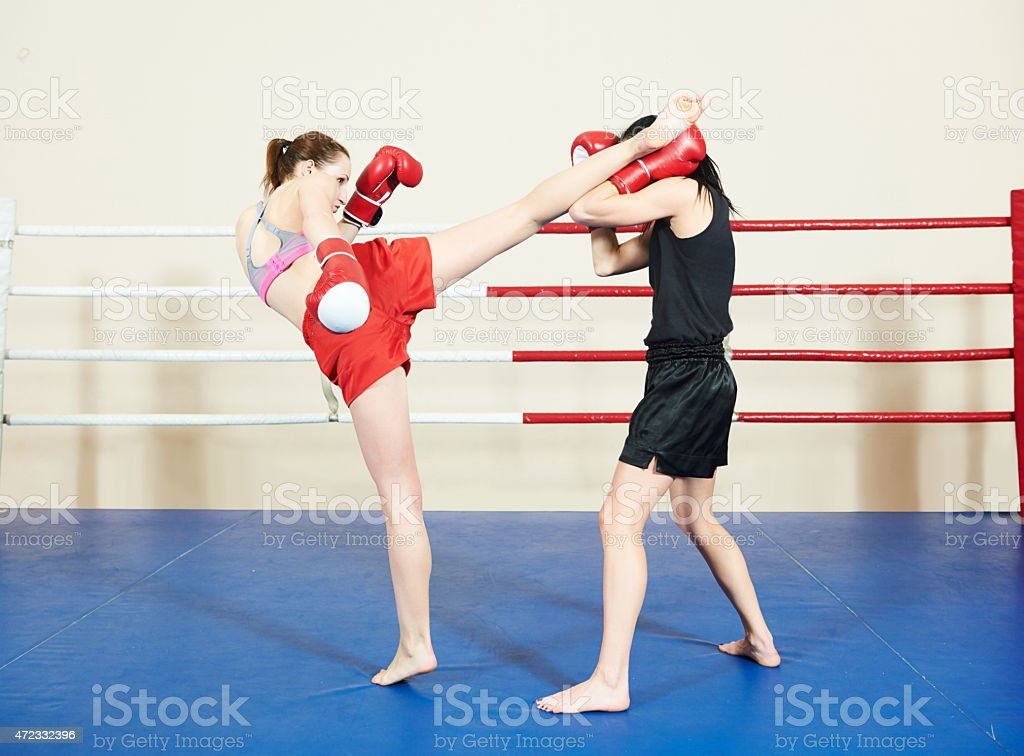 muai thai fighting women stock photo