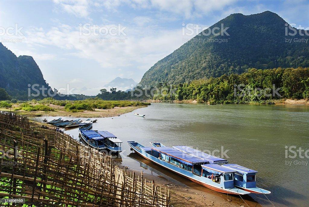 Muang Ngoi boats stock photo