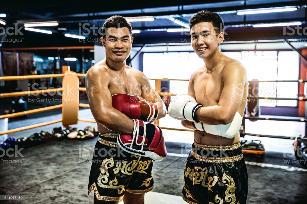 Muay Thai athletes posing in the ring after the fight stock photo