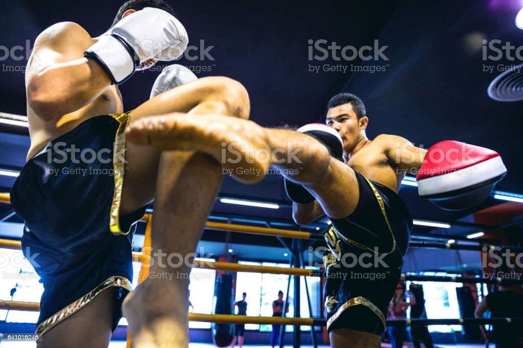 Muay Thai match on boxing ring in Thailand stock photo