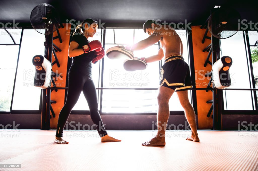 Muay Thai workout - Motivational training at the gym facility stock photo